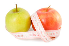 Pink measuring tape and two apples Royalty Free Stock Image