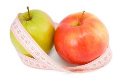 Pink measuring tape and two apples Royalty Free Stock Photography