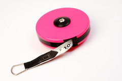 Pink measuring tape  on white. Stock Photography