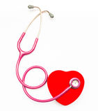Pink medical stethoscope and heart Stock Photos