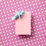 Pink memo pad, sticky note on pink fabric background. Pink memo pad, sticky note on pink dot pattern fabric background royalty free stock image