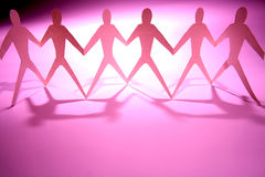 Pink Men. Pink chain men holding hands for gay rights Royalty Free Stock Photo