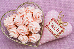 Pink meringue in heart shaped basket with soft fabric heart by, Royalty Free Stock Photo