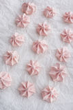 Pink meringues on baking paper Royalty Free Stock Images