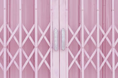 Pink metal grille sliding door Stock Images