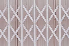 Pink metal grille sliding door Stock Image