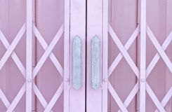 Pink metal grille sliding door with handle Stock Images