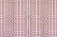 Pink metal grille sliding door Royalty Free Stock Photography