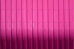 Pink metal sheet pattern and vertical line design. Metal sheet pattern and vertical line design on surface abstract aluminum architecture background blank bright stock photos