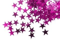 Pink metallic stars. Pink decorative metallic stars on white background Stock Photo