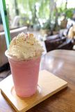 Pink milk cold drink for summer so delicious, sweet cold strawberry fresh milk and bread with fluffy whipped cream. Those are placed on the wooden table royalty free stock images