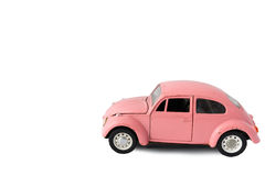 Pink model car, Toy. Bangkok, Thailand - March 26 2017:  Volkswagen beetle model, side of old pink car on white background, Isolated Stock Photography