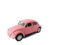 Pink model car, Toy. Bangkok, Thailand - March 26 2017:  Volkswagen beetle model, side of old pink car on white background, Isolated Stock Photos