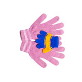 Pink mom's gloves holding small babies glove Royalty Free Stock Image