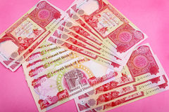 The Pink Money. Central Bank of Iraq Dinar 25,000 notes, commonly called The Pink Money or The Pink Currency, newly printed in 2003. Selective focus Stock Photos