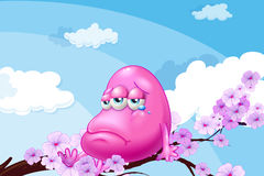 A pink monster at the branch of a tree Royalty Free Stock Photos