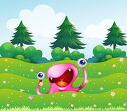 A pink monster near the pine trees Stock Photography
