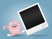 Pink monster and photo frame. Stock Image