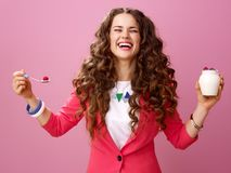 Happy young woman isolated on pink with farm organic yogurt Royalty Free Stock Photo