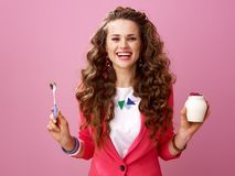 Happy trendy woman with farm organic yogurt and spoon Stock Images