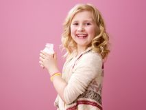 Smiling child on pink background with farm organic yogurt Royalty Free Stock Photos