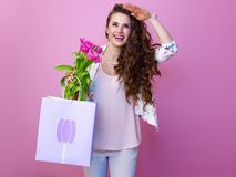 Woman with a bouquet of flowers and shopping bag Stock Photo