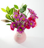 Pink Mother's Day Flowers. Pretty pink flowers in pink Mother's Day vase for mom Stock Photos