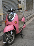 Pink motorbike on the street in Kunming, China Royalty Free Stock Photography