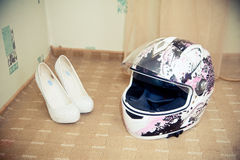 Pink motorcycle helmet and women's shoes Royalty Free Stock Images