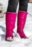 Pink mountain shoes Standing on the snow . Royalty Free Stock Photo