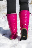 Pink mountain shoes Standing on the snow . Stock Images