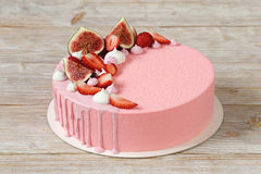 Pink mousse cake with mirror glaze and merinques Royalty Free Stock Photo