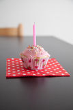 Pink Muffin with birthday candle Royalty Free Stock Photography