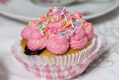 Pink muffin. Pink cream blueberry muffin on a  table Royalty Free Stock Photos