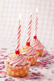 Pink muffins with candles Stock Images