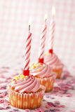 Pink muffins with candles Stock Photography