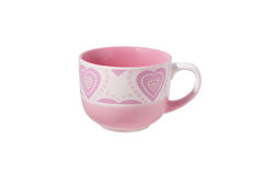 Pink mug with a heart pattern. Stock Photography