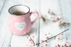 Pink mug and flowers on white background stock photo