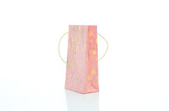 Pink mulburry paper bag on white background Stock Photos