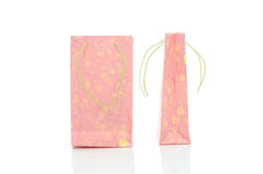 Pink mulburry paper bag on white background Stock Images