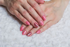 Pink nail art with flower on textile Royalty Free Stock Images