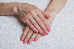 Pink nail art with flower on textile Royalty Free Stock Photography