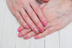 Pink nail art with gold roses Stock Photography