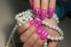 Pink nail design with decoration stock image