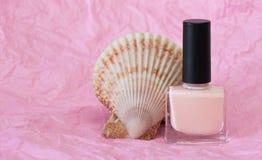 Pink nail polish. Pink nail polish on a pink background Royalty Free Stock Image