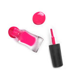 Pink nail Polish in the bottle near the hand Royalty Free Stock Photos