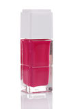 Pink nail polish bottle with reflection Stock Images