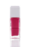 Pink nail polish bottle with reflection Royalty Free Stock Photography