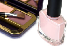 Pink nail polish and Eye shadow. On a white background Royalty Free Stock Photo