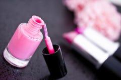 Pink nail polish and flower petal Royalty Free Stock Images